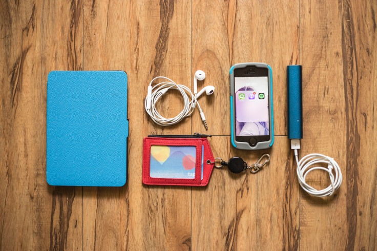 Metro Kit: Kindle, Headphones, Tap card in a retractable ID holder, Phone with useful apps, Portable charger.